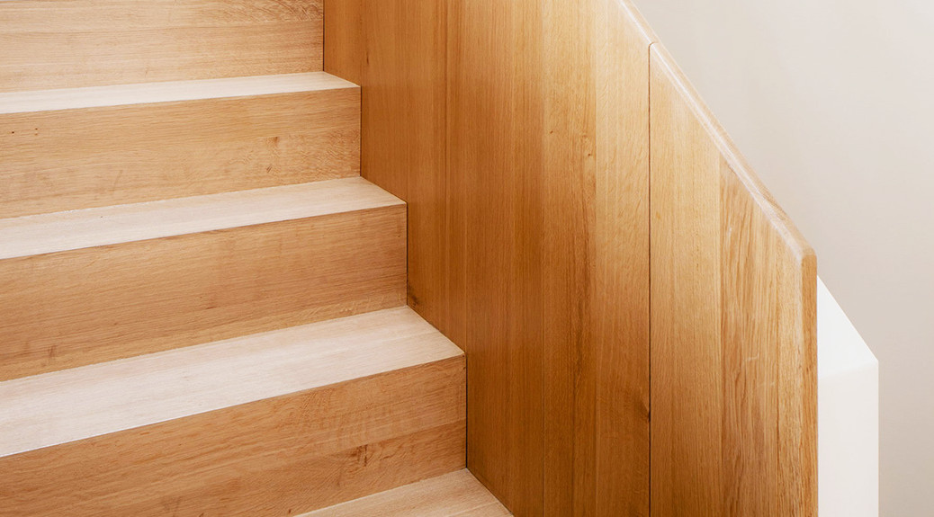 modern-wood-laminate-stairs-design-with-light-brown-color